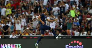 Harry Kane: Tottenham forward celebrates his stunning goal from the halfway line in pre-season against Juventus