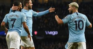 Sergio Aguero (right) celebrates his hat-trick for Manchester City against Arsenal