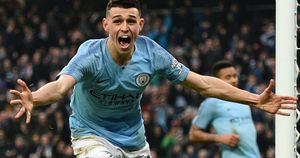 Phil Foden celebrates after scoring against Rotherham