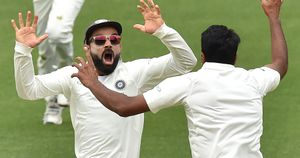 India's captain Virat Kohli (L) celebrates with spin bowler Ravichandran Ashwin (R) after beating Australia