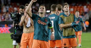 Dusan Tadic and Ajax celebrate their Champions League win at Valencia