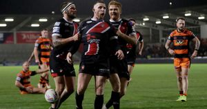 Jackson Hastings of Salford celebrates after scoring a try