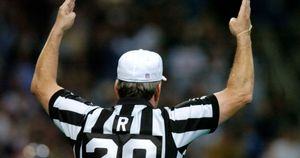 An NFL referee signals a touchdown