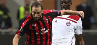 Yaya Toure in action for Olympiakos against AC Milan in the Europa League
