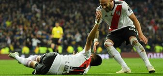 Gonzalo Martinez (left) celebrates River Plate's third goal
