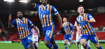 Fejiri Okenabirhie celebrates his goal for Shrewsbury at Stoke in the FA Cup