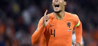Virgil van Dijk celebrates after scoring for the Netherlands against Germany
