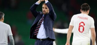 Gareth Southgate applauds the England fans after the win over Spain