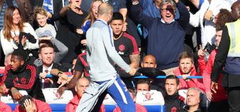 Chelsea's Marco Ianni celebrates in front of Jose Mourinho