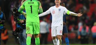 Wayne Rooney shares a joke with Brad Guzan