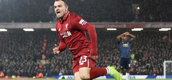 Xherdan Shaqiri scores for Liverpool against Manchester United