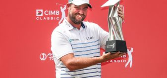 Marc Leishman with the CIMB Classic trophy