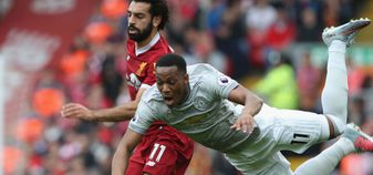 Mo Salah and Anthony Martial in action during Liverpool v Manchester United at Anfield