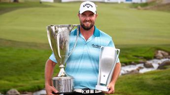 Marc Leishman shows off his silverware