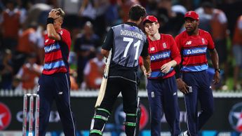 England's Eoin Morgan shakes hands with Colin de Grandhomme