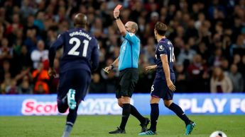 Mike Dean brandishes a red card - arguably the highlight of the match