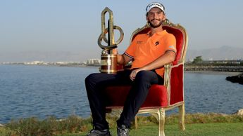 Joost Luiten is all smiles with the NBO Oman Open trophy