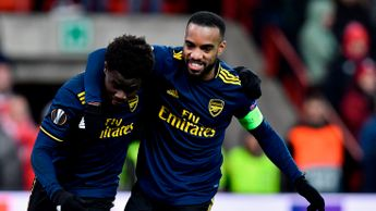 Arsenal celebrate a goal at Standard Liege