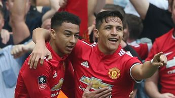 Alexis Sanchez celebrates with Jesse Lingard