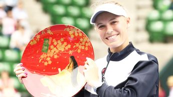 Caroline Wozniacki celebrates winning the Toray Pan Pacific Open