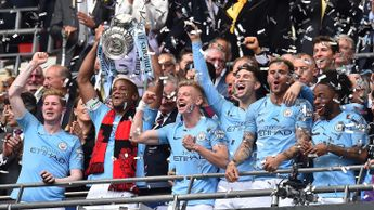 Vincent Kompany lifts the FA Cup as Man City secure a historic treble