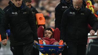 Alex Oxlade-Chamberlain is stretchered off during Liverpool v Roma