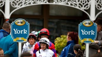 Jockeys leave the York weighing room