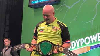 Michael van Gerwen with the Champions League of Darts belt (Picture: Paddy Power on Twitter)