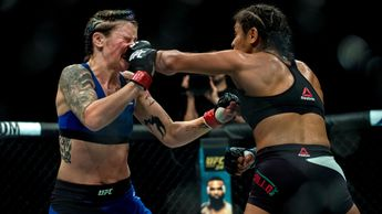 Joanne Calderwood (blue shorts) is defeated by Cynthia Calvillo