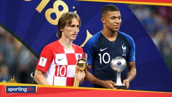 Luka Modric (left) collects his World Cup Golden Boot award, while Kylian Mbappe wins young player of the tournament