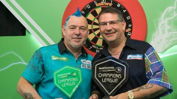 Gary Anderson and Peter Wright after the Champions League of Darts final (Picture: Lawrence Lustig)