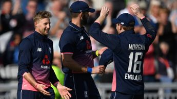 Joe Root, Liam Plunkett and Eoin Morgan celebrate
