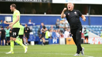 Chris Wilder celebrates after victory over QPR