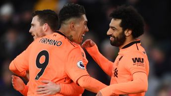 Roberto Firmino and Mohamed Salah celebrate