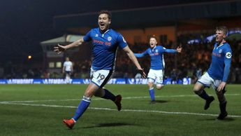 Steve Davies celebrates Rochdale's late equaliser against Tottenham