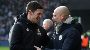Huddersfield caretaker Mark Hudson and Manchester City manager Pep Guardiola
