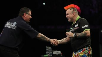 Gary Anderson and Peter Wright shake hands after an epic encounter (Pic: Lawrence Lustig/PDC)