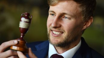 Joe Root with the Ashes urn