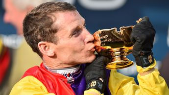 Richard Johnson kisses the Cheltenham Gold Cup