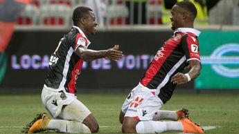 Jean Michael Seri (left) celebrates with Nice team-mate Wylan Cyprien