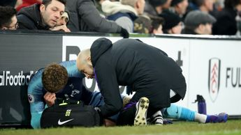 Dele Alli receives treatment at Craven Cottage