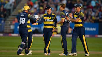 Glamorgan celebrate the wicket of Ian Cockbain