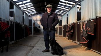 Trainer Colin Tizzard stands with his dog