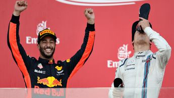 Daniel Ricciardo celebrates on the podium