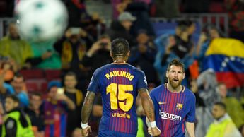 Paulinho and Lionel Messi celebrate