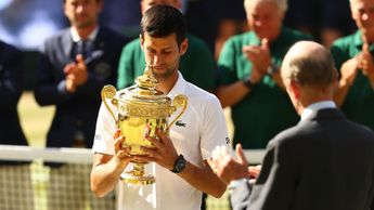 Novak Djokovic with the Wimbledon trophy