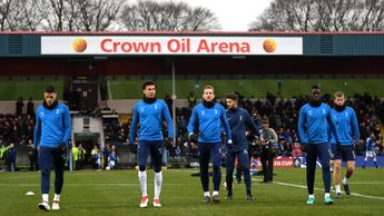 Tottenham's players warm up at Rochdale
