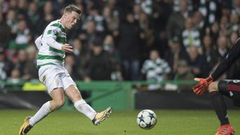 Callum McGregor scores for Celtic during the Champions League