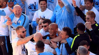 Vincent Kompany is mobbed on stage during the trophy parade in Manchester