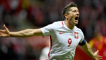 Poland striker Robert Lewandowski celebrates